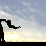 woman-dancing-with-son